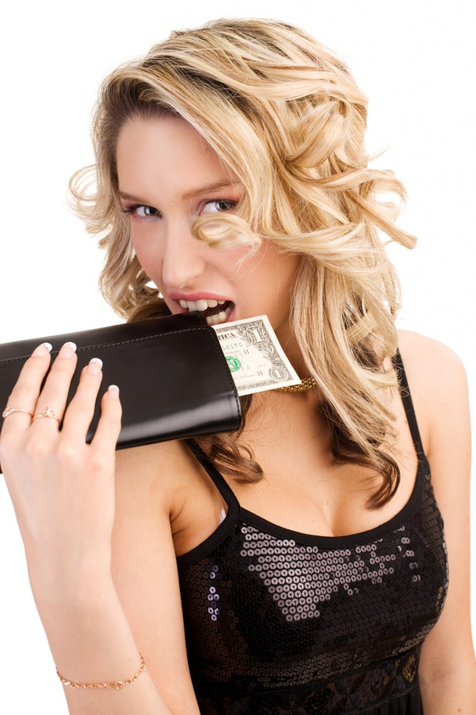 http://www.dreamstime.com/royalty-free-stock-image-woman-biting-wallet-image7294386
